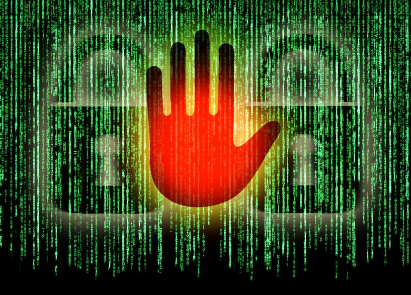 Symbol of internet security with binary character hand and padlock to represent ransomware
